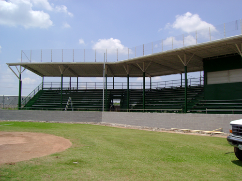 The grandstand, with its fresh coat of paint and new backstop wall